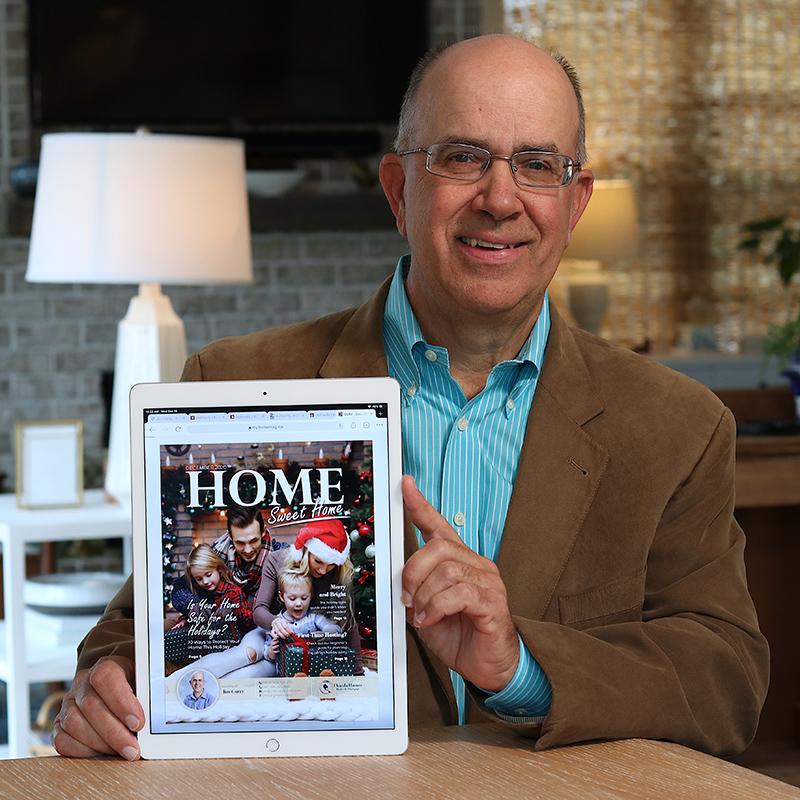 Jim Curry Showing a Digital Magazine